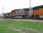 BNSF power heads in at Moline siding, while IAIS 703/713/719 stand by to pick up the train.
