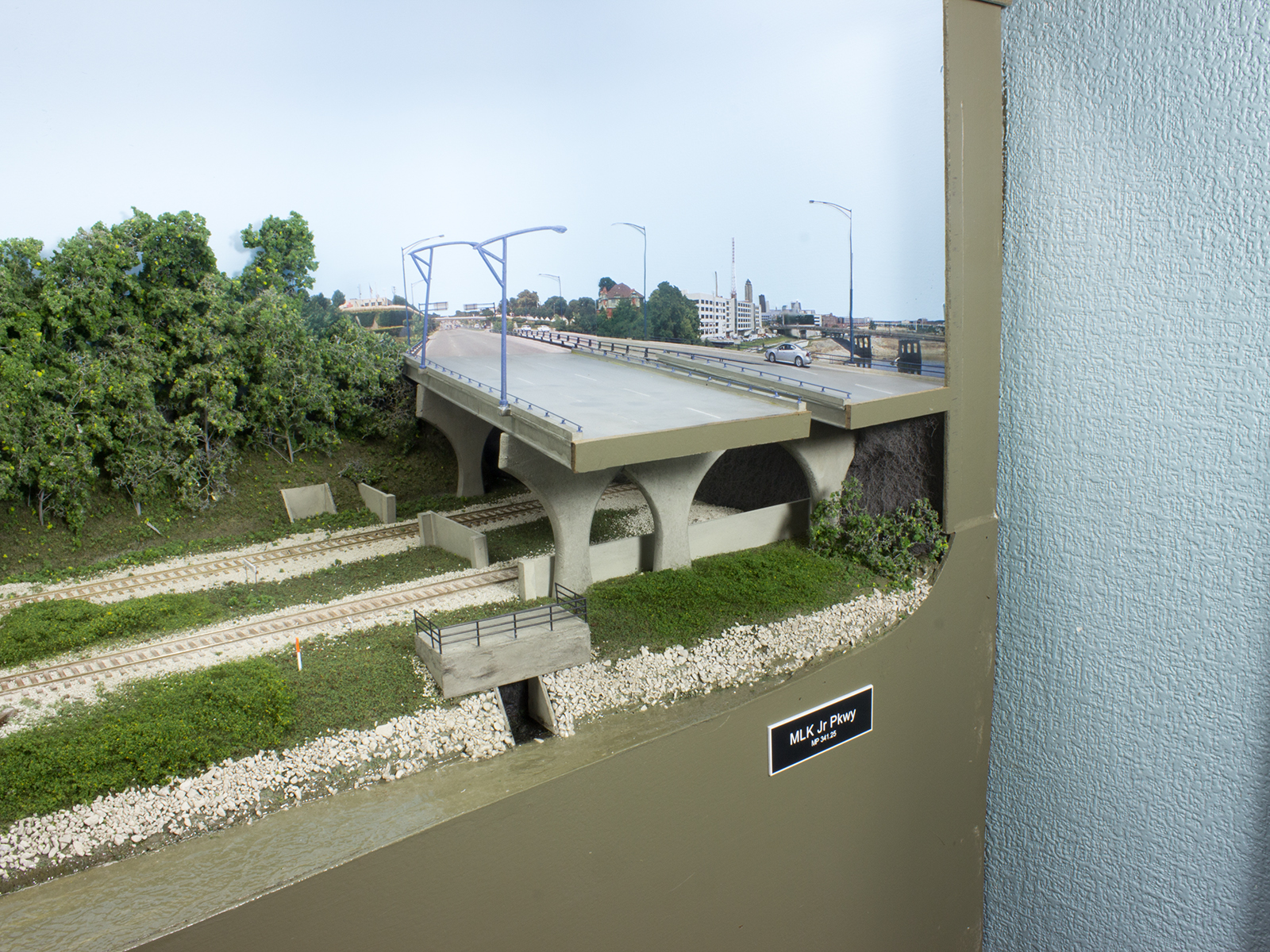 The MLK Jr. Parkway passes over the middle of the prototype yard, but serves as the eastern boundary of the model. The photo backdrop was created from street view shots in Google Earth.