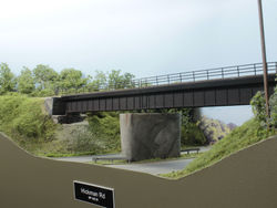 The signature scene of the Grimes Line is the ballasted deck girder bridge over Hickman Road/US Highway 6.