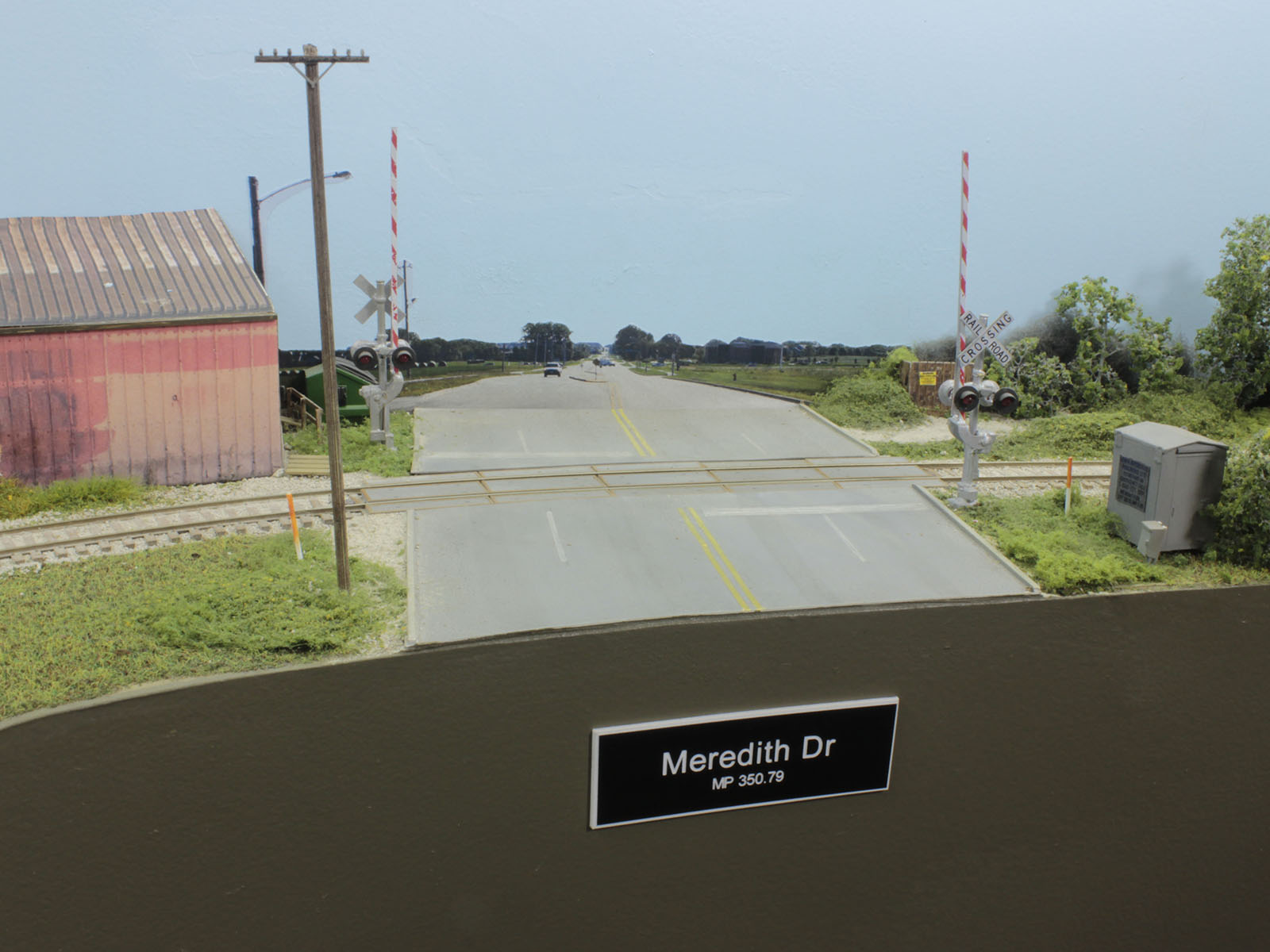 North of the Urbandale runaround, trains will shove across Meredith Drive enroute to Beisser Lumber. Meredith is the only grade crossing with gates for protection. Pallet Recyclers, a non rail-served industry, is located on the north side of the road.