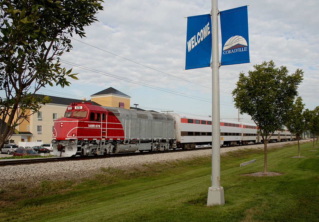 The Hawkeye Express heads east with another load of fans from the depot at Coralville, IA.  02-Sept-2006.