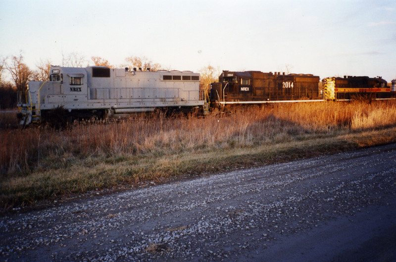 NREX 2007 and 2014 lead a coal train at Homestead, Dec. '95, before they were repainted.