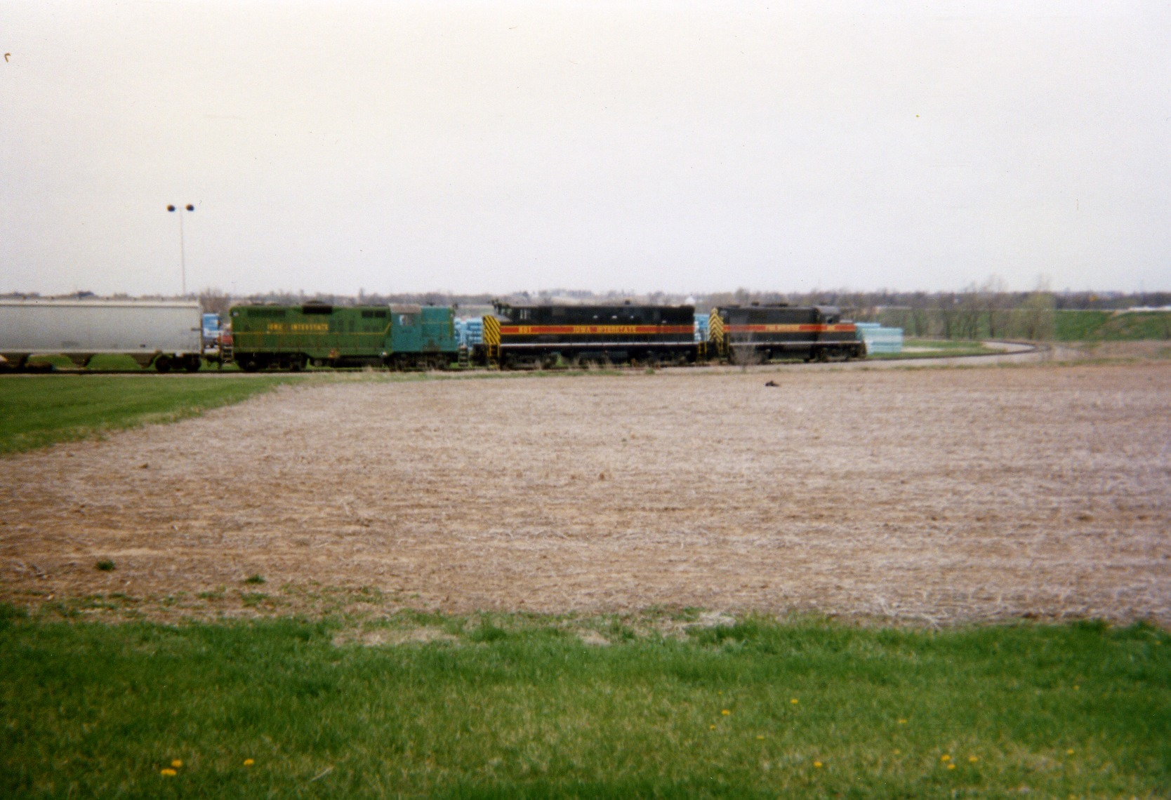 Perhaps the rarest consist ever seen on JM's spur, 900/801/303 switch the plant.  Sorry about the poor quality of this photo, but it's one of my favorites.  May 2, 1996.
