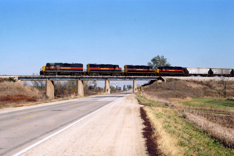 Westbound on the Hancock overpass; lead unit 702 is directly over the former Oakland branch, now used for car storage.  This day there were 8 or 10 HS flats stored there.  Oct. 25, 2005.