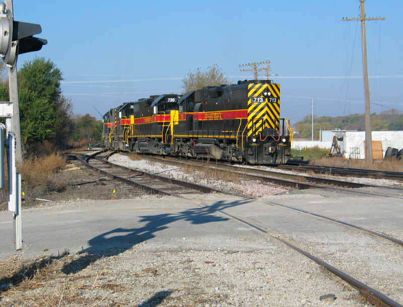 West train power backing through the crossover west of the Depot at Atlantic, to run around their hoppers.  Oct. 25, 2005.