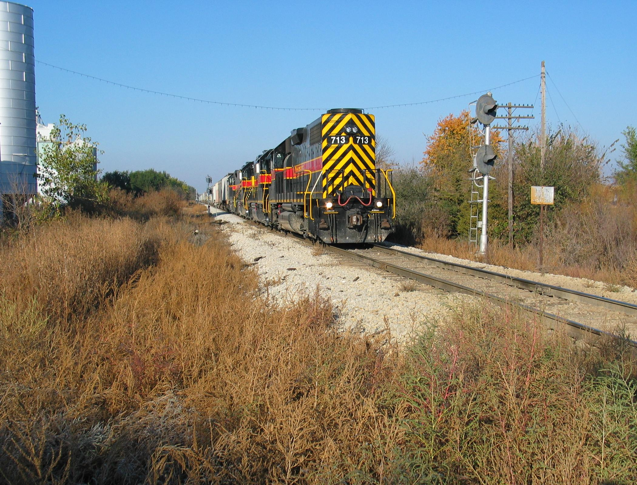 Power coupling onto the east end of the hoppers at Atlantic, getting ready to shove up to Harlan; Oct. 25, 2005.  This switch was the start of CTC into the Bluffs in RI days.