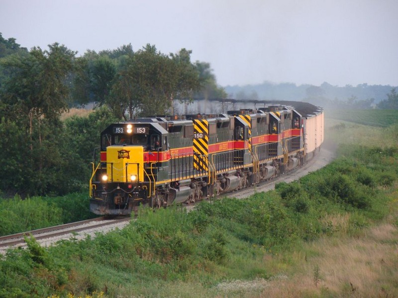 The ICCR crests the hill southwest of Walford, Iowa with NOKL hoppers,  07/26/2008.