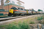 Westbound at Mo. Div. Jct. (Taylor St.) Davenport, June 29, 2005.  Second car is an AOK loaded with CSXU containers.